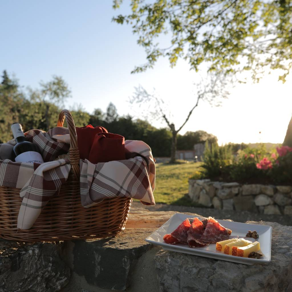 Tuscany picnic with a bottle of wine